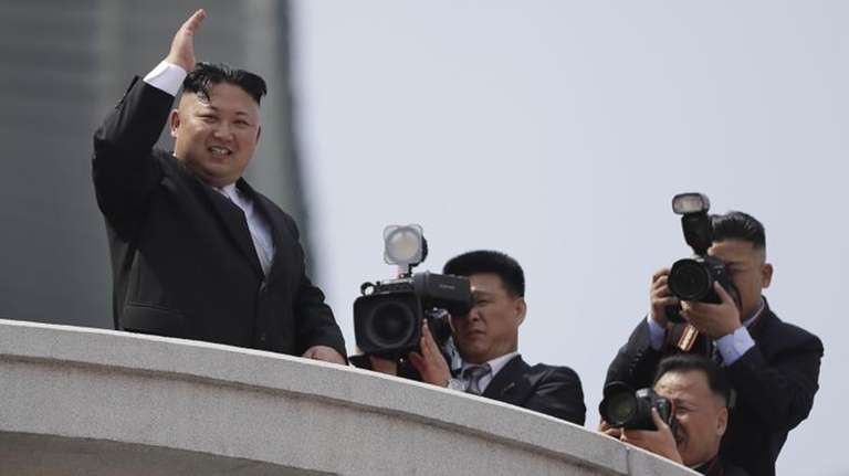North Korean leader Kim Jong Un waves during