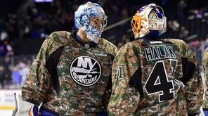 New York Islanders goalies Thomas Greiss, left, and