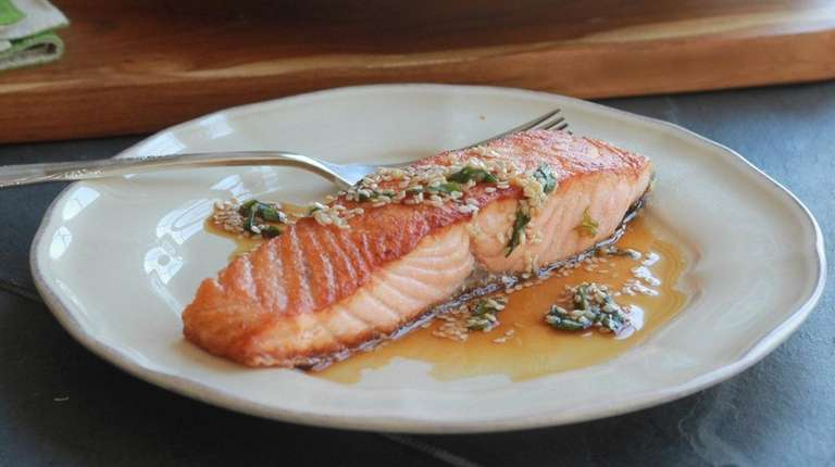 Seared salmon topped with a sauce made from