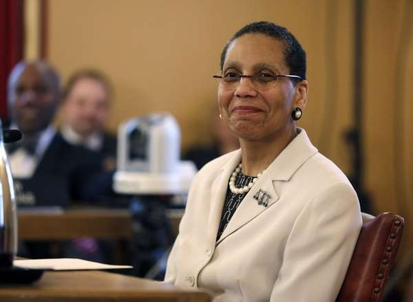 Judge Sheila Abdus-Salaam looks on as members of