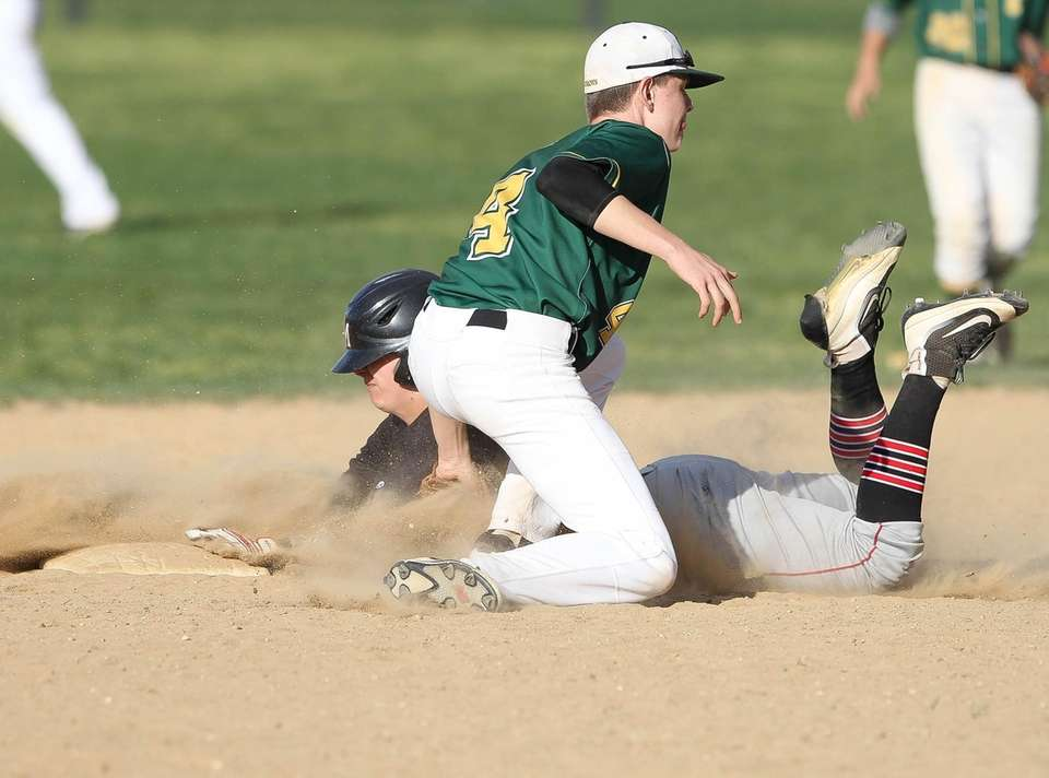 Ward Melville's Logan Doran (4) tags Patchogue-Medford's Cameron