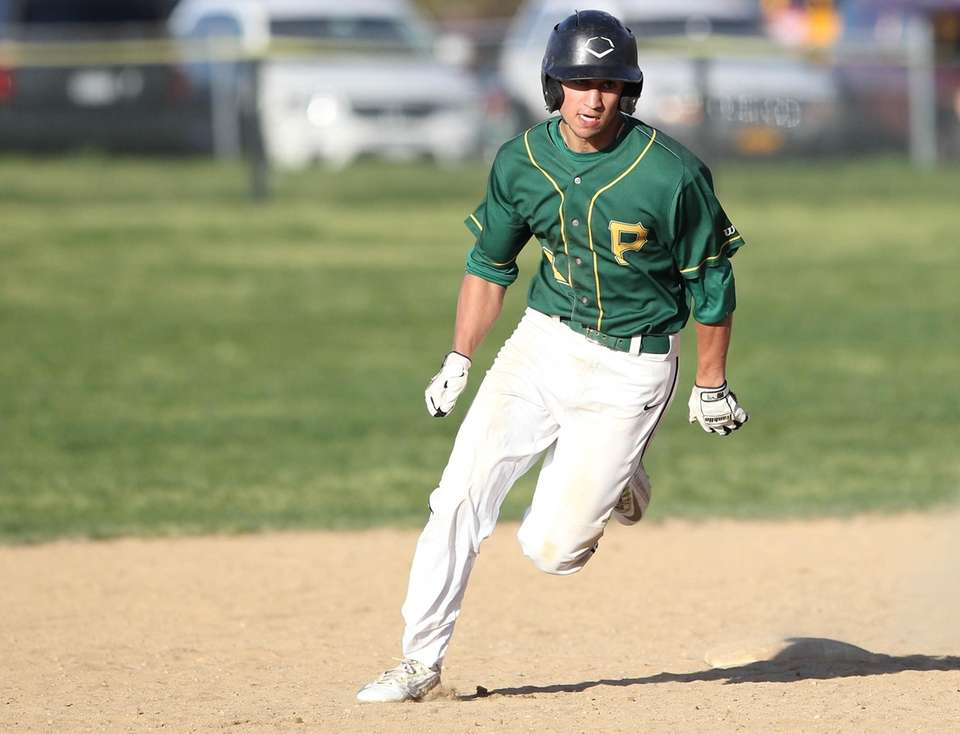 Ward Melville's James Curcio (2) rounds second after