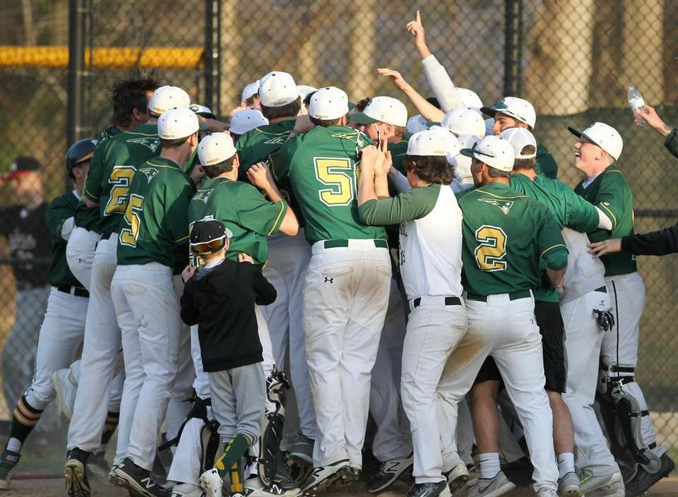 Ward Melville's players surround Logan Doran after he