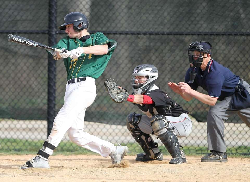 Ward Melville's Tom Hudzik gets a base hit