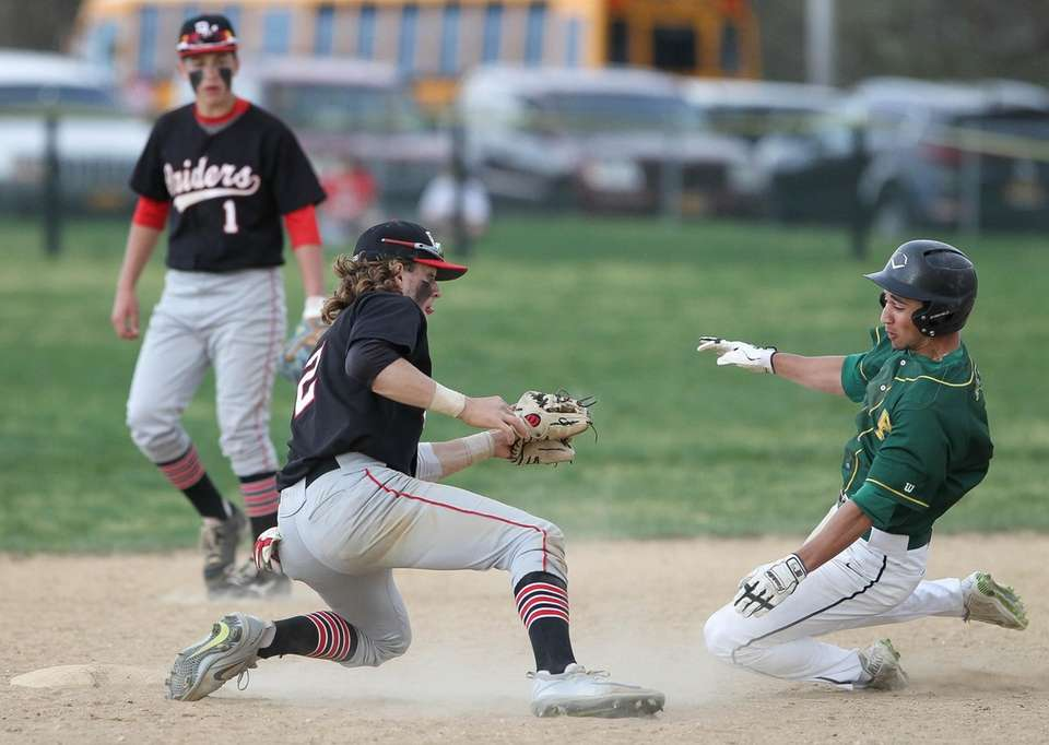 Ward Melville's James Curcio (2) gets tagged out