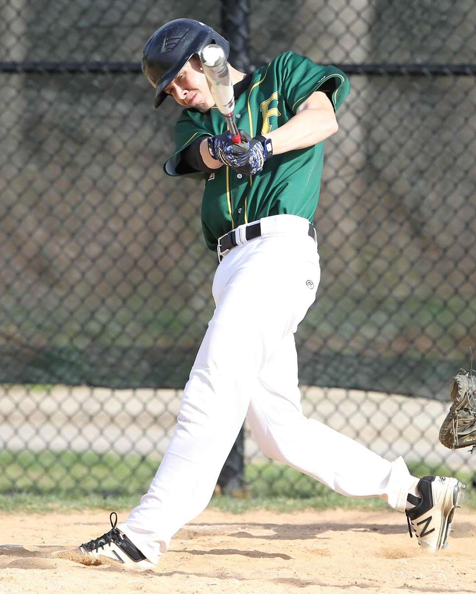 Ward Melville's Logan Doran (4) gets an RBI