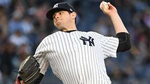Yankees starting pitcher Jordan Montgomery delivers a pitch