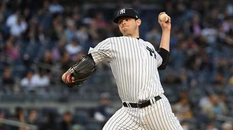 New York Yankees' Jordan Montgomery delivers a pitch