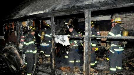 Firefighters at the scene after a fire destroyed