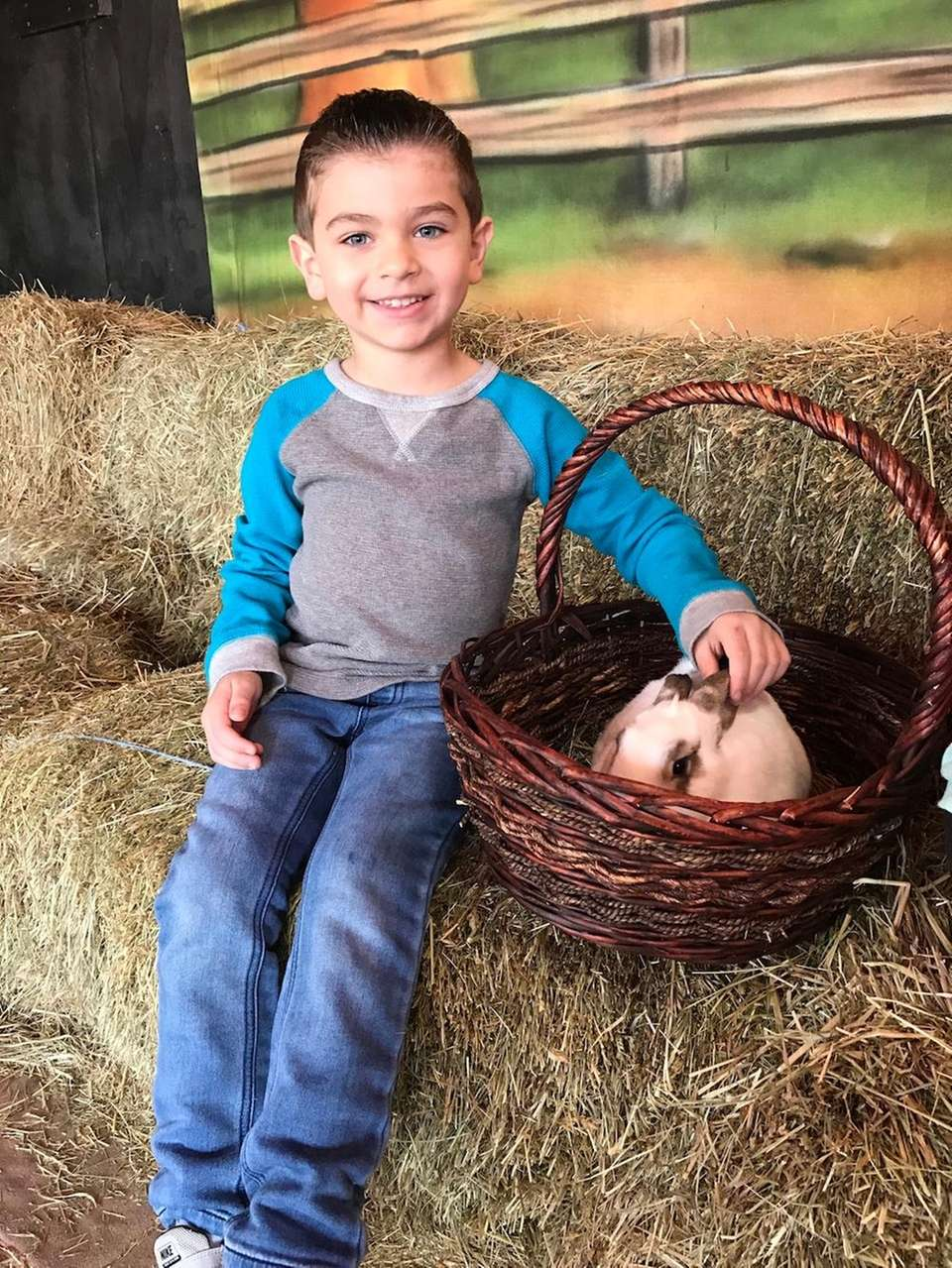 CJ Latwaitis age 5, petting bunnies day before