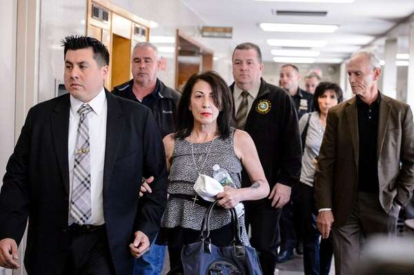 Cathi Vetrano (center) leaves after the arraignment of