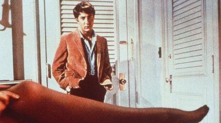 Dustin Hoffman looks over the stockinged leg of