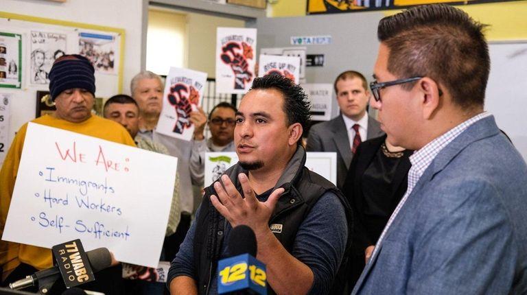 Juan Barahona, of Hempstead, left, says he was