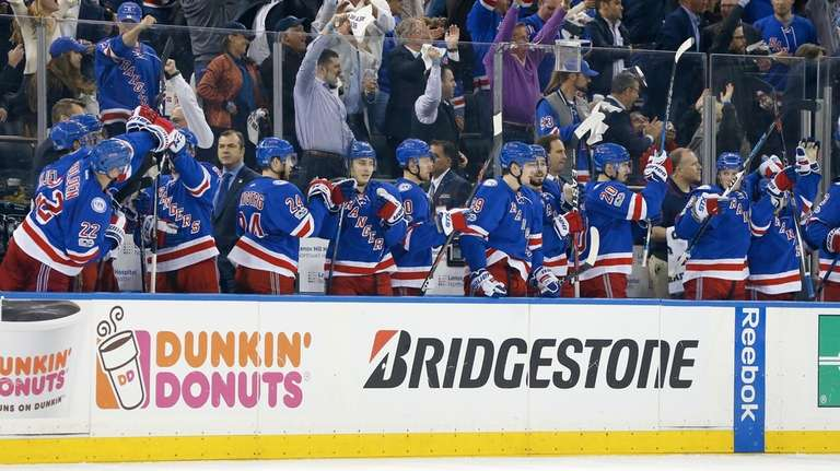 The New York Rangers bench celebrates a second