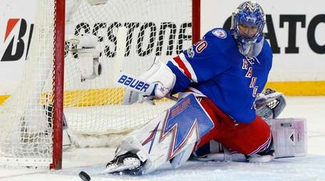 Henrik Lundqvist of the New York Rangers makes
