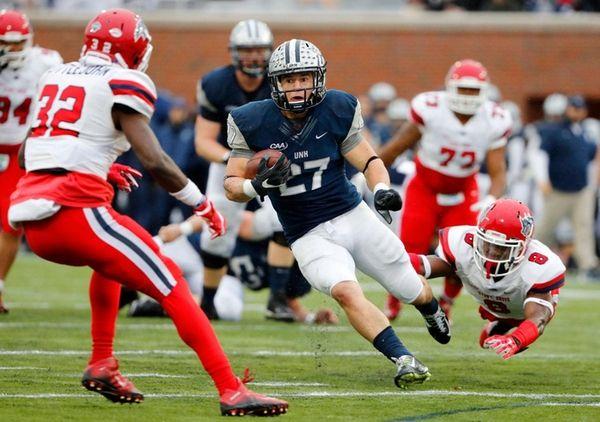 New Hampshire Wildcats running back Dalton Crossan runs