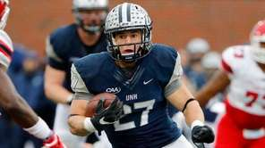 New Hampshire Wildcats running back Dalton Crossan runs