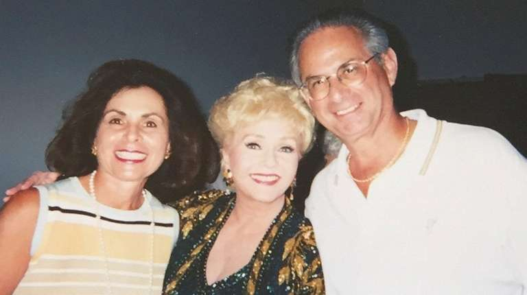 Dr. Bernard Levine, right, is shown with Debbie