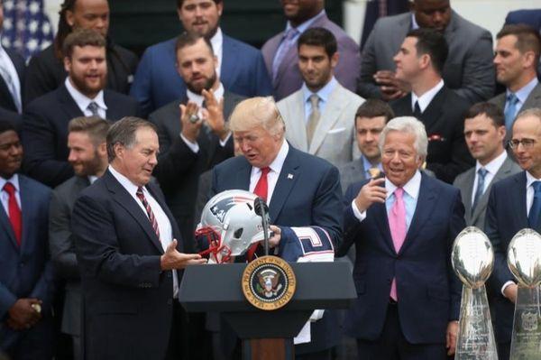 New England Patriots head coach Bill Belichick presents