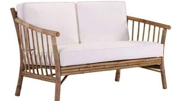 The bamboo loveseat with white cotton cushions would