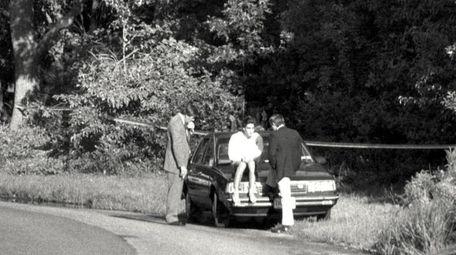 Suffolk homicide detectives James McCready (left) and Robert