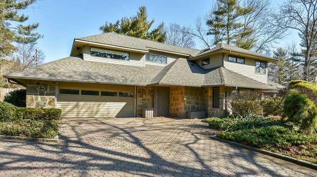 This five-bedroom, four-bath Roslyn Heights home was built