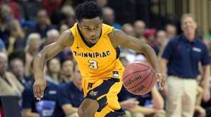 Quinnipiac guard Mikey Dixon (3) steals a ball