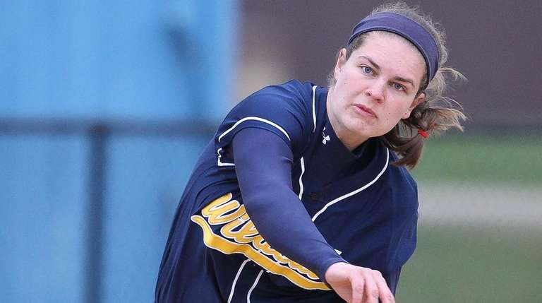Shoreham Wading River's Lindsey McKenna (15) throws out