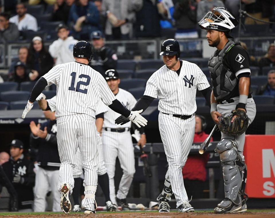 New York Yankees third baseman Chase Headley, left,
