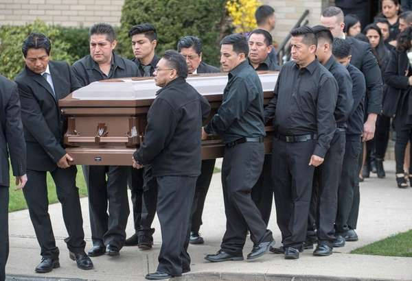 The body of Justin Llivicura being carried out
