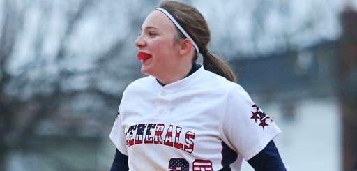 Lisa Fabig #20 of MacArthur reacts against Clarke