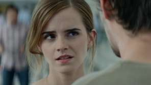 A young woman (Emma Watson) begins working for