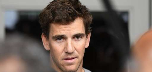 New York Giants quarterback Eli Manning answers questions