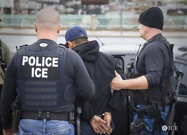 Immigration and Customs Enforcement agents make an arrest