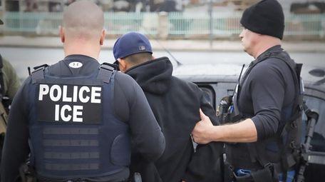 Immigration and Customs Enforcement agents make an arrest