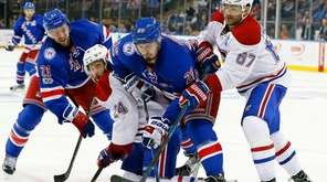 Derek Stepan #21 and Chris Kreider #20 of