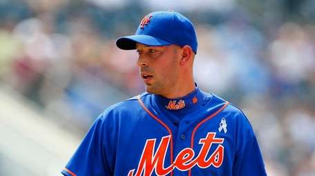 Pitching for the Mets, righthander David Aardsma looks