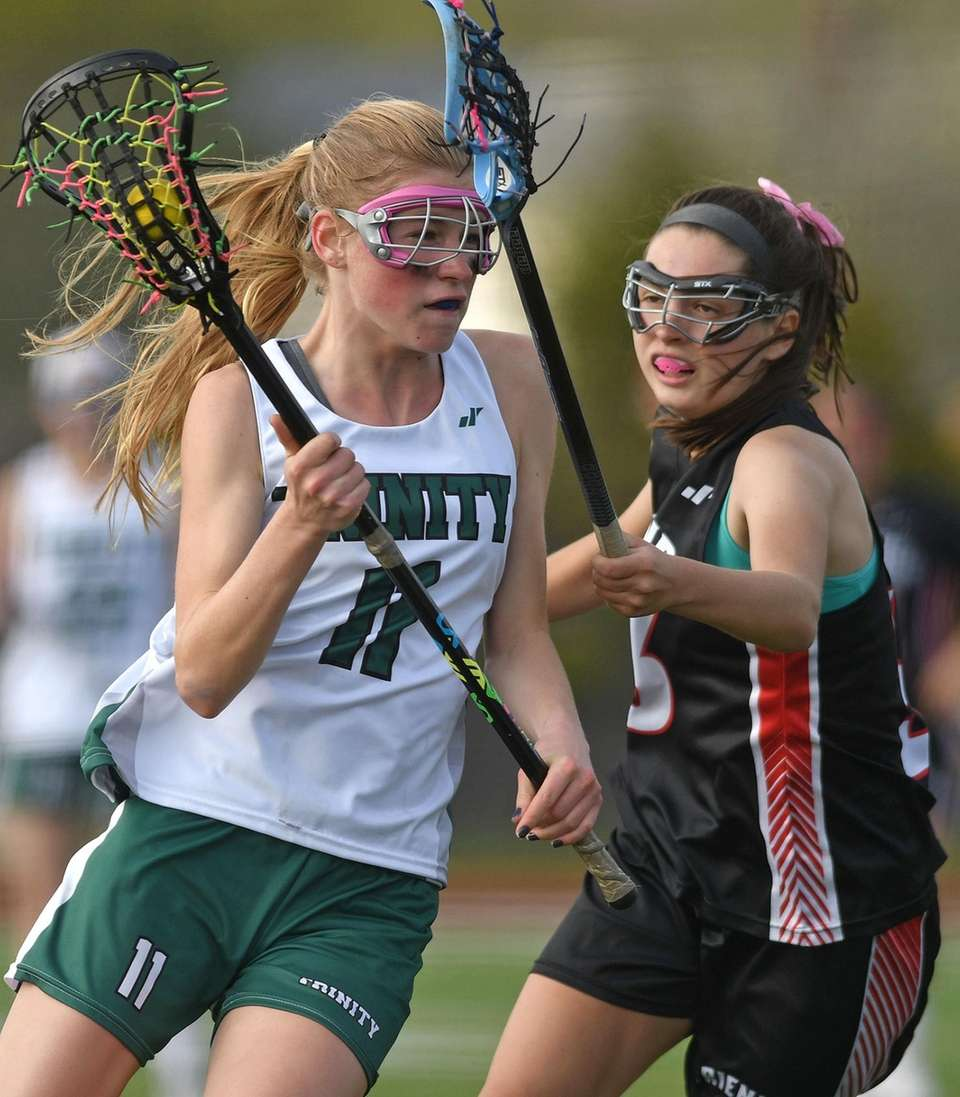 Mary Zarba #11 of of Holy Trinity, left,