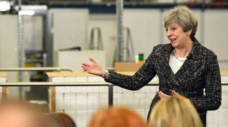 British Prime Minster Theresa May delivers remarks at