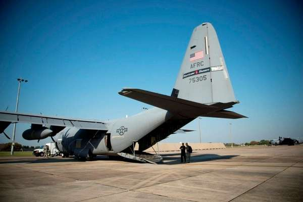 A WC-130J Hurricane Hunter aircraft prepares for takeoff