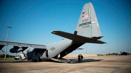 A WC-130J Hurricane Hunter aircraft prepares for takeoff