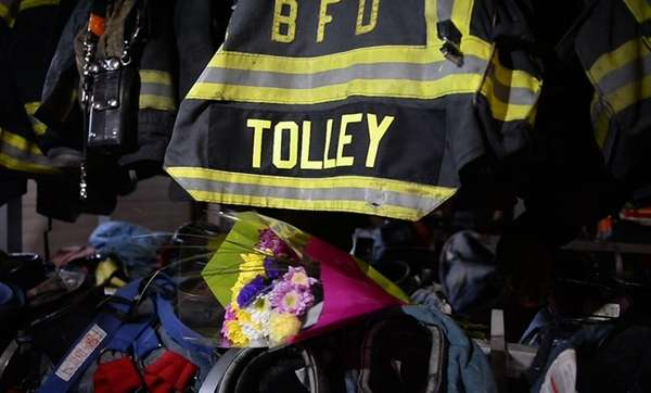 A large portrait of Firefighter William Tolley hung between