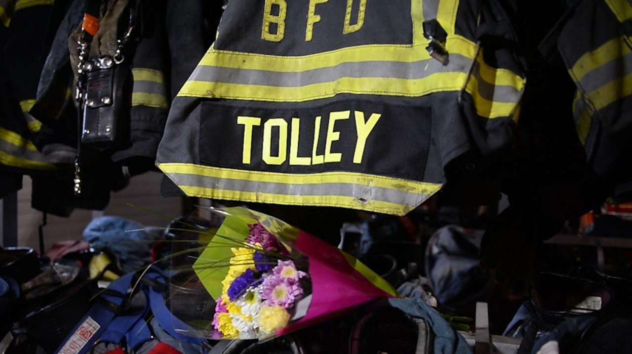 Alarge portrait of Firefighter William Tolley hung between