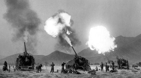 A 155 mm howitzer crew fires in Korea