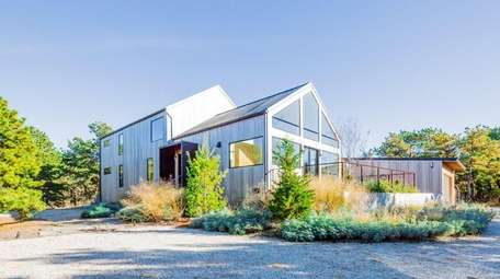 The five-bedroom house abuts the 160-acre Napeague State