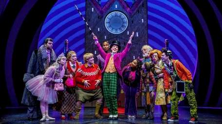 Christian Borle as Willy Wonka, center, works hard
