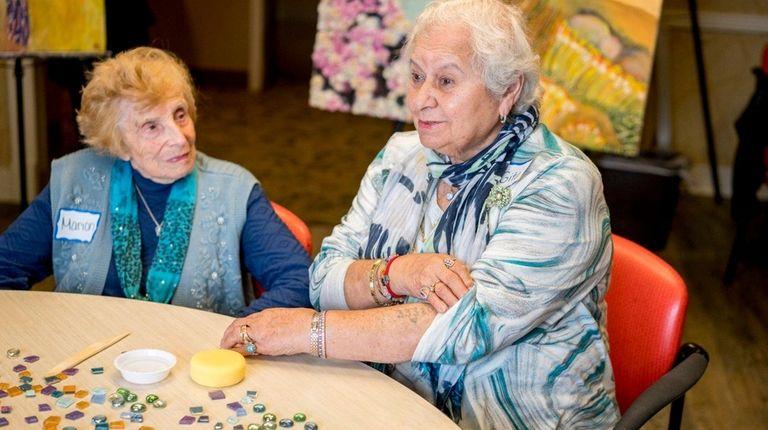 Gita Shorr, right, with Marion Weiner, talk at