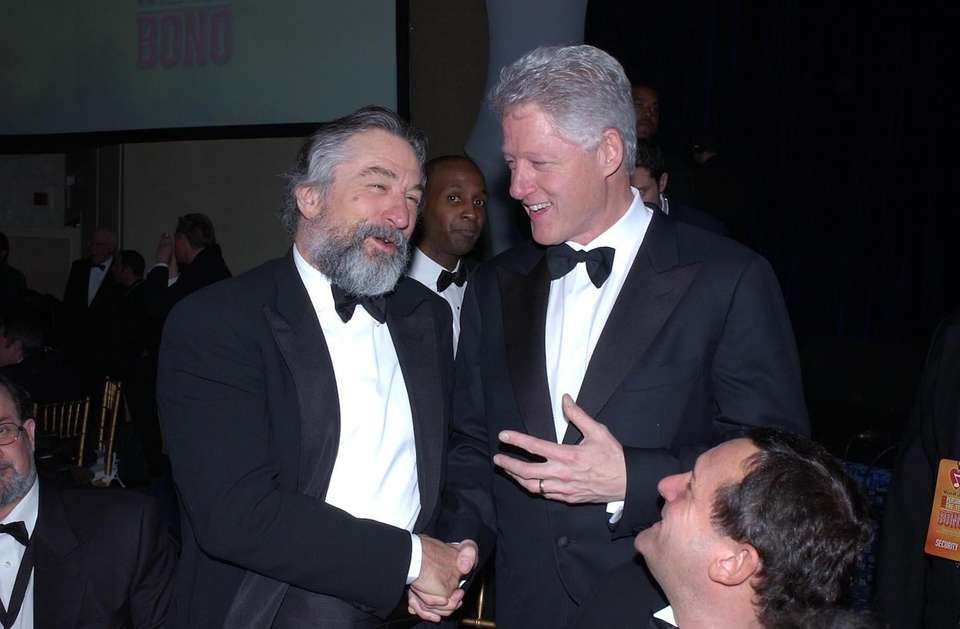 Actor Robert De Niro greets former President Bill