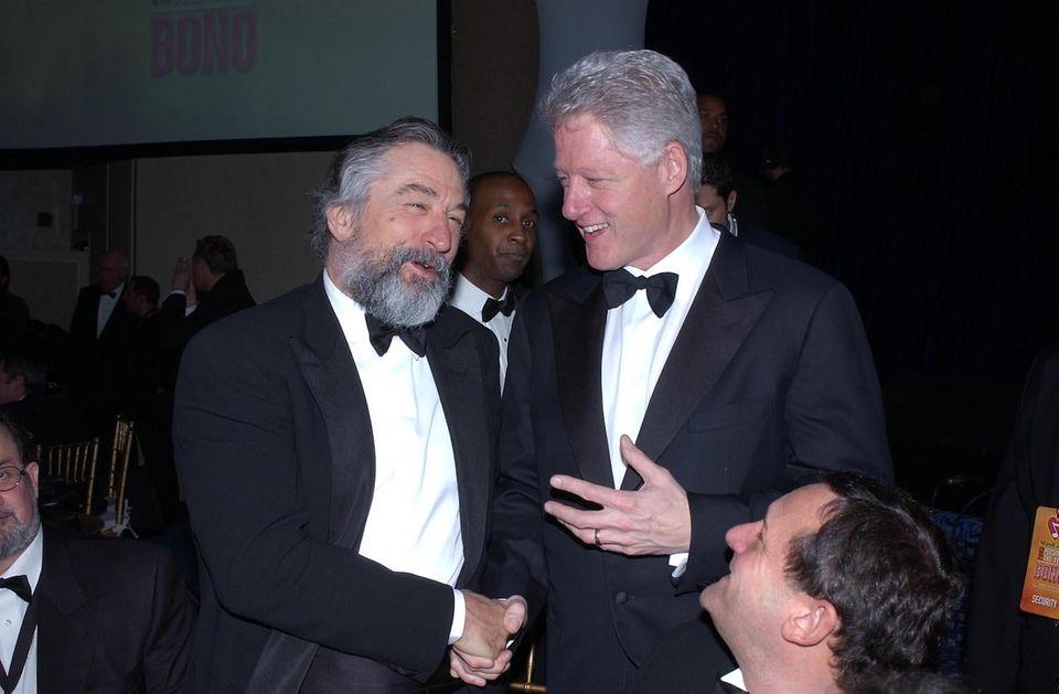 Actor Robert De Niro greets former President Bill