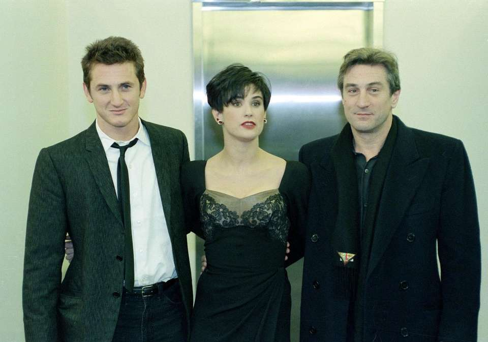 Actors Sean Penn, left, with Demi Moore and